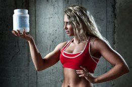 athletic-woman-holding-a-container-with-protein